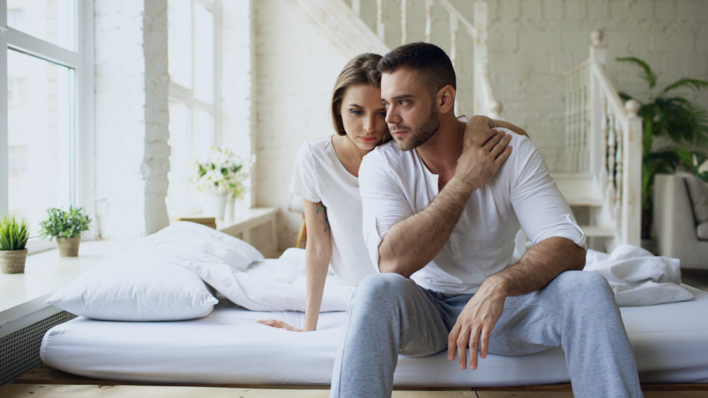 wife comforting husband